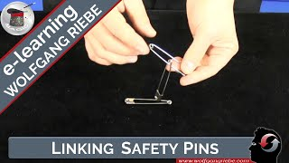 Watch how large safety pins link and unlink magically!