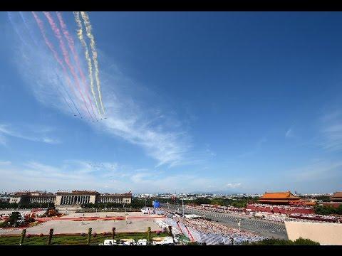 1. Aircraft formations parade through Beijing sky