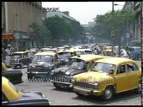 Yellow Ambassador taxis vie for space on Kolkata's crowded roads