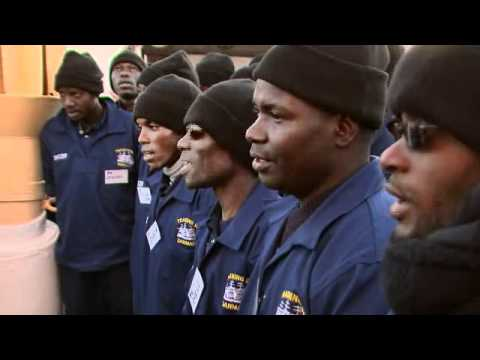 Angolan cadets sing at muster on Training Ship Danmark