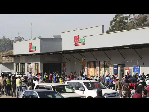 People queue to buy food after deadly protests in eSwatini capital