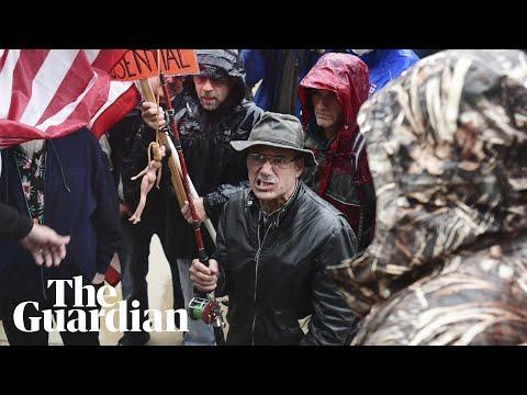 Armed coronavirus lockdown protesters clash at Michigan's state capitol