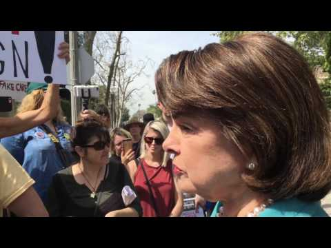 """Dianne Feinstein interacting with demonstrators from """"Indivisible CA-43"""", 3/17/2017"""