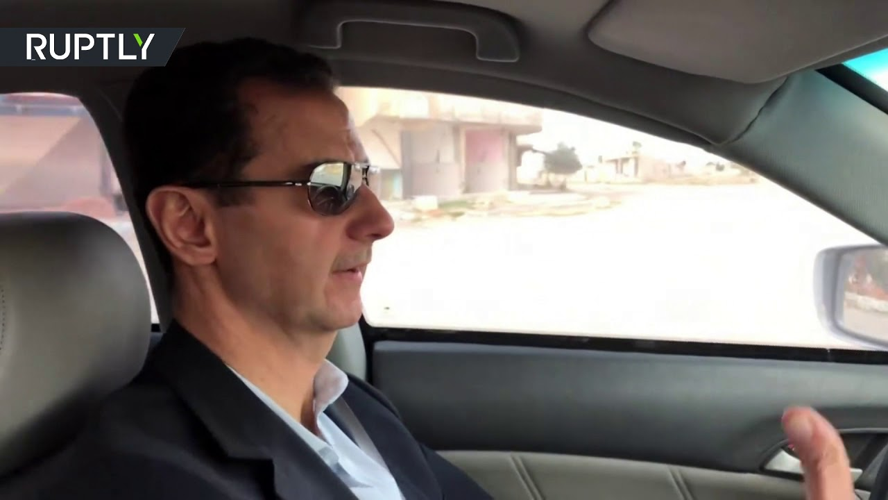 Bashar Assad drives through the streets of Ghouta