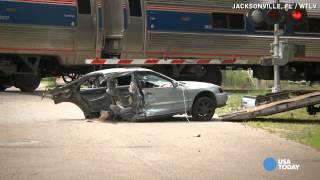 Video shows Amtrak train slice car in half