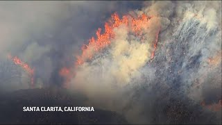 Crews battle brush fire north of Los Angeles