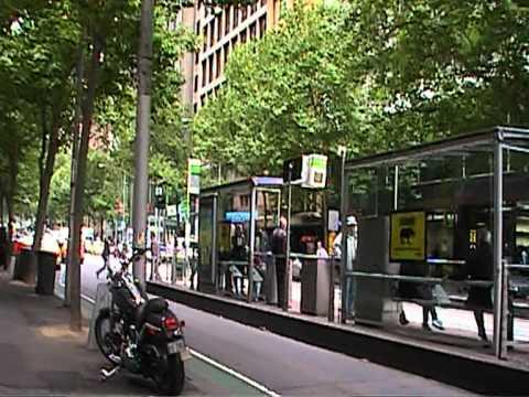 walking along side Collins street in Melbourne, Australia
