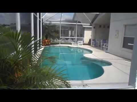 THE LAKE AND POOL AT THE BEST VALUE EAGLE POINT RENTAL HOMES KISSIMMEE ORLANDO FLORIDA USA