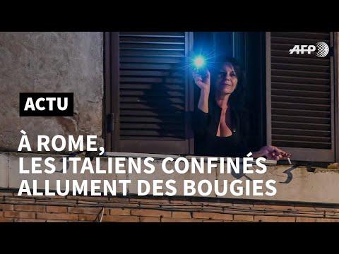 Coronavirus: à Rome, les Italiens allument des bougies à leurs fenêtres | AFP News