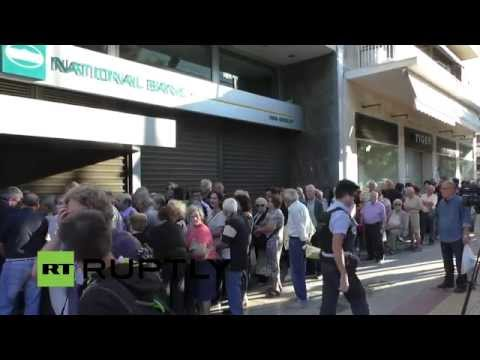 LIVE: People line up at banks as Greek referendum day looms