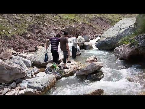 Trout fishing with net in Pakistan. Tanveer Jadoon.