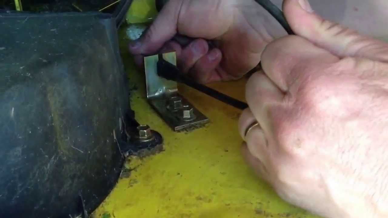 tightening the belt on a john deere l110 tractor