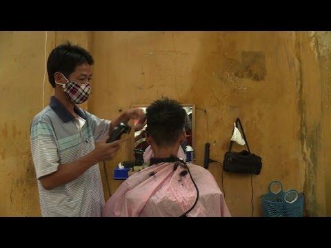 A cut above: Hanoi's deft sidewalk barbers