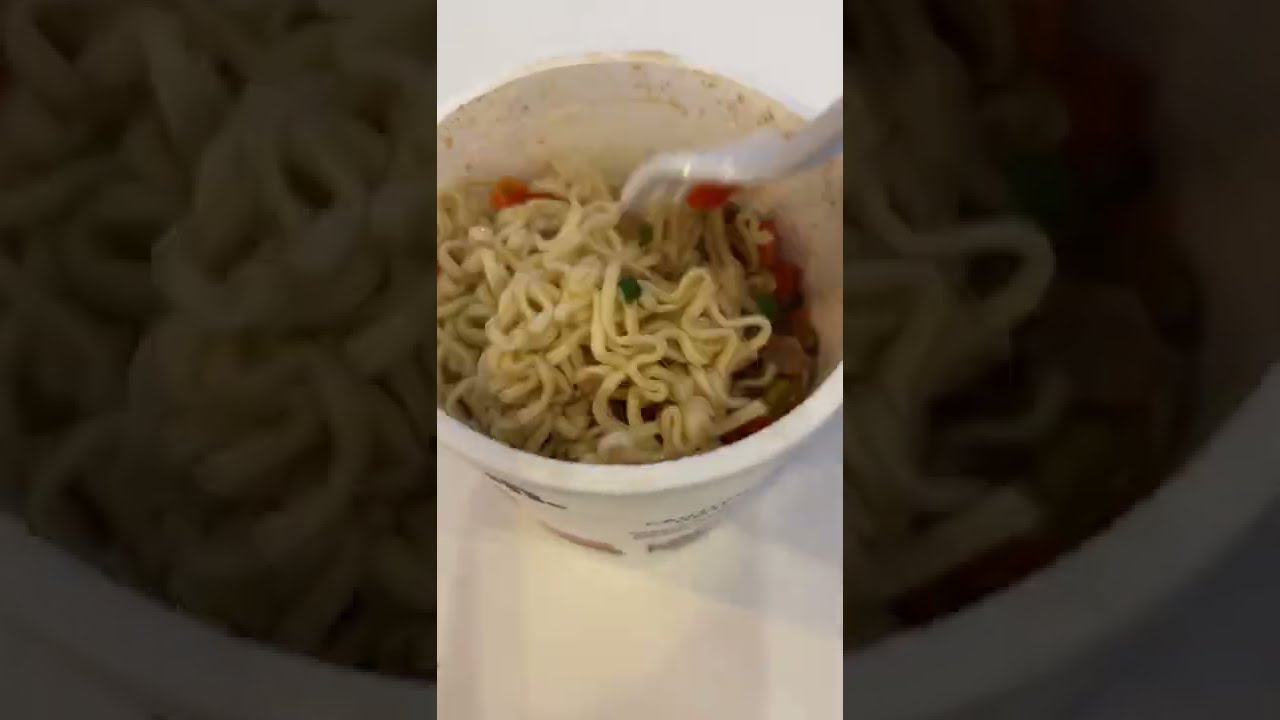 Eating instant ramen at a hotel