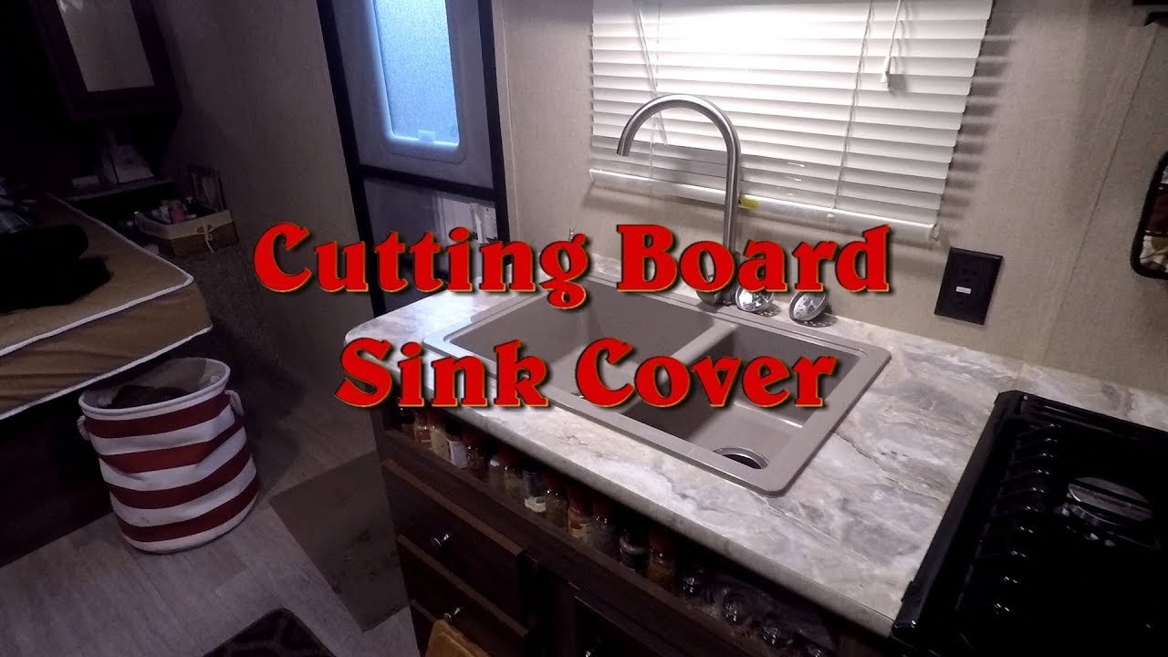 adding a cutting board sink cover in our coleman travel trailer