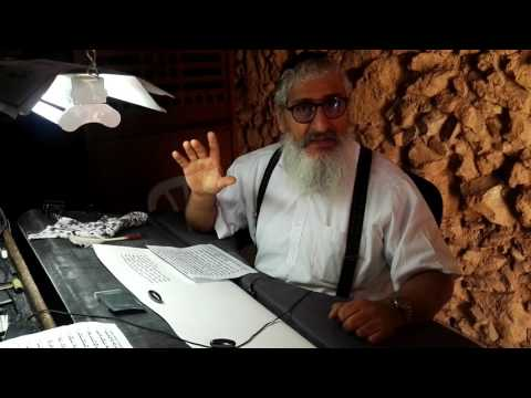 A Jewish scribe at Masada Israel writes the book of Leviticus. Guide: Zahi Shaked. April 27, 2017