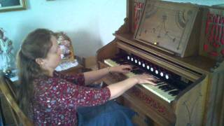 Cindy playing an antique pump organ