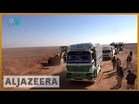 🇺🇳🇸🇾 UN aid trucks reach remote refugee camp in Syria | Al Jazeera English