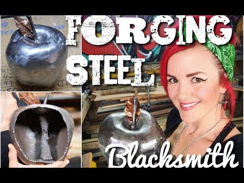 Blacksmith - Forging a metal artwork - End World Hunger