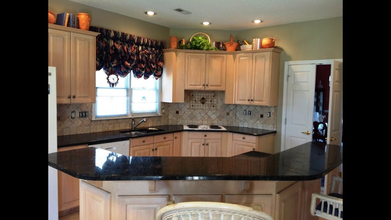 What Goes With Black Kitchen Cabinets Granite Countertops Charlotte- Verde Peacock On Light Wood