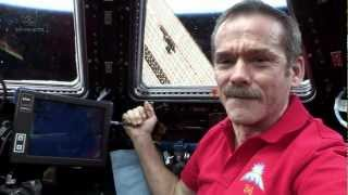 Hadfield behind the controls of Canadarm2