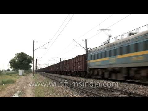 Freight train passing by the tracks