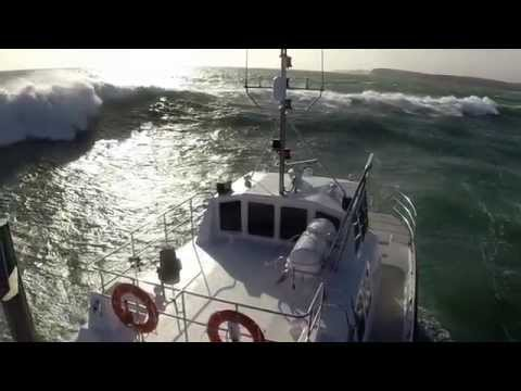 Drone video of Wildcat 53 during rough weather trials and GoPro footage of her in breaking waves