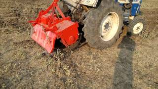 ROTAVAOR OR ROTARY TILLER IN FIELD WITH SWARAJ TRACTOR