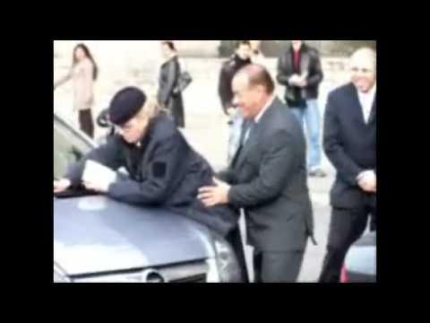 Silvio Berlusconi (HQ) jokes with a careless parking guard