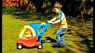 Little Boy playing with Teddy Bear and Cozy Coupe Trolley Cart