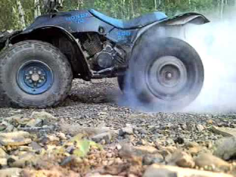 Big Four Wheelers >> 4 wheeler burnout on car tires - YouTube