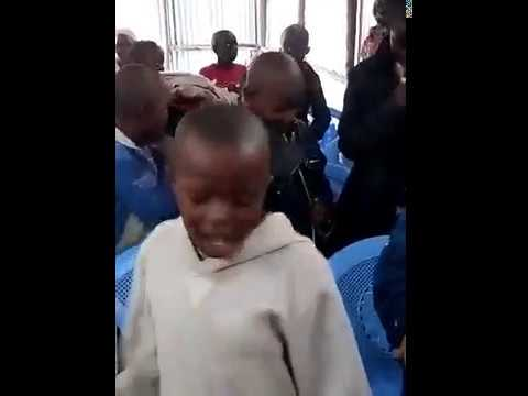 Children Signing GMFC WFF Kibera SLum Kenya