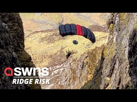 Heart-in-mouth-moment-two-daredevils-jump-off-the-narrowest-ridge-in-the-UK-SWNS