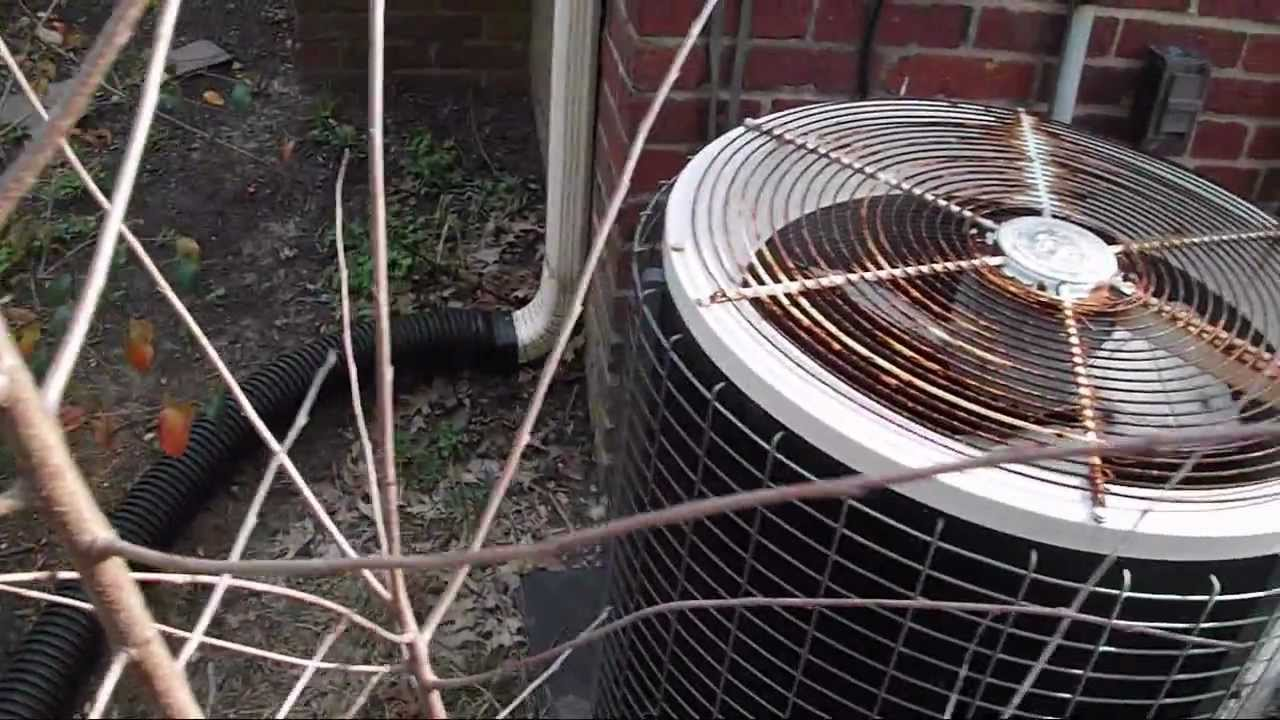 Old Amana air-conditioner (not running) and Ducane heat pump running in  HEAT mode