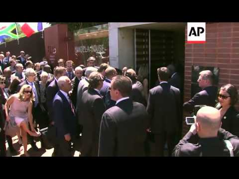 French President Hollande visits Soweto and the offices of the Mandela Foundation