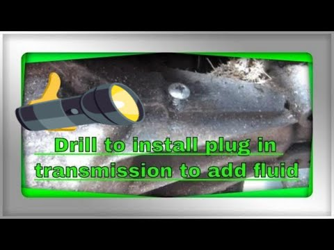 Drill to install plug in transmission to add fluid