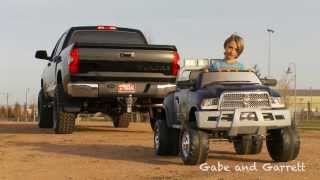 2014 Toyota Tundra vs Kid Trax Dodge Ram - Tug Of War!
