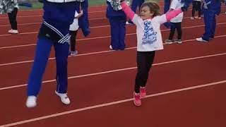 Pro cheerleader.  Nailed that kick!