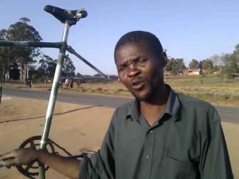 Malawi's Kajinga shows his bicycle creation....