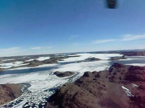 Antarctica Flying among lakes