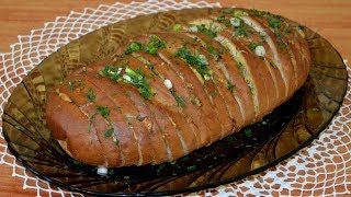 Батон запеченный с сыром, чесноком и зеленью. Baked loaf with cheese, garlic and greens.