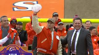 Dabo Swinney kissing the coaches award crystal ball