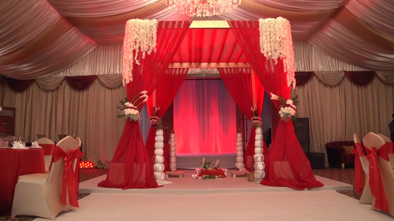 red and gold themed wedding setup.