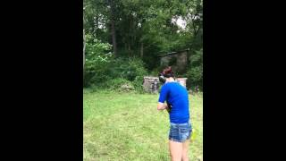 Asian chic shooting clay frisbies with Mossberg