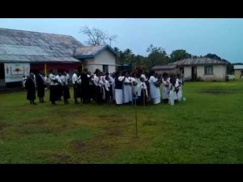 An entire Fiji village singing to another one. Religious festival