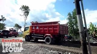 Mitsubishi Colt Dump Truck unloading Gravel for asphalt layer