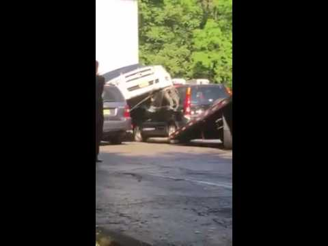 A flatbed tower tries to disengage the SUVs in a video shot by James Butterworth.