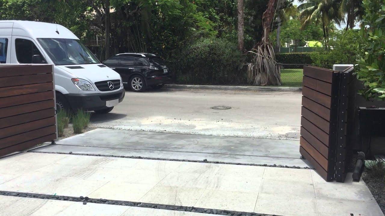 Bi Fold Swing Gate Installed In Miami Beach Florida By Aa Same Day Garage Door Service Inc