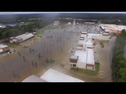 Reservoirs overflow and levee fails, sending more water in neighborhoods