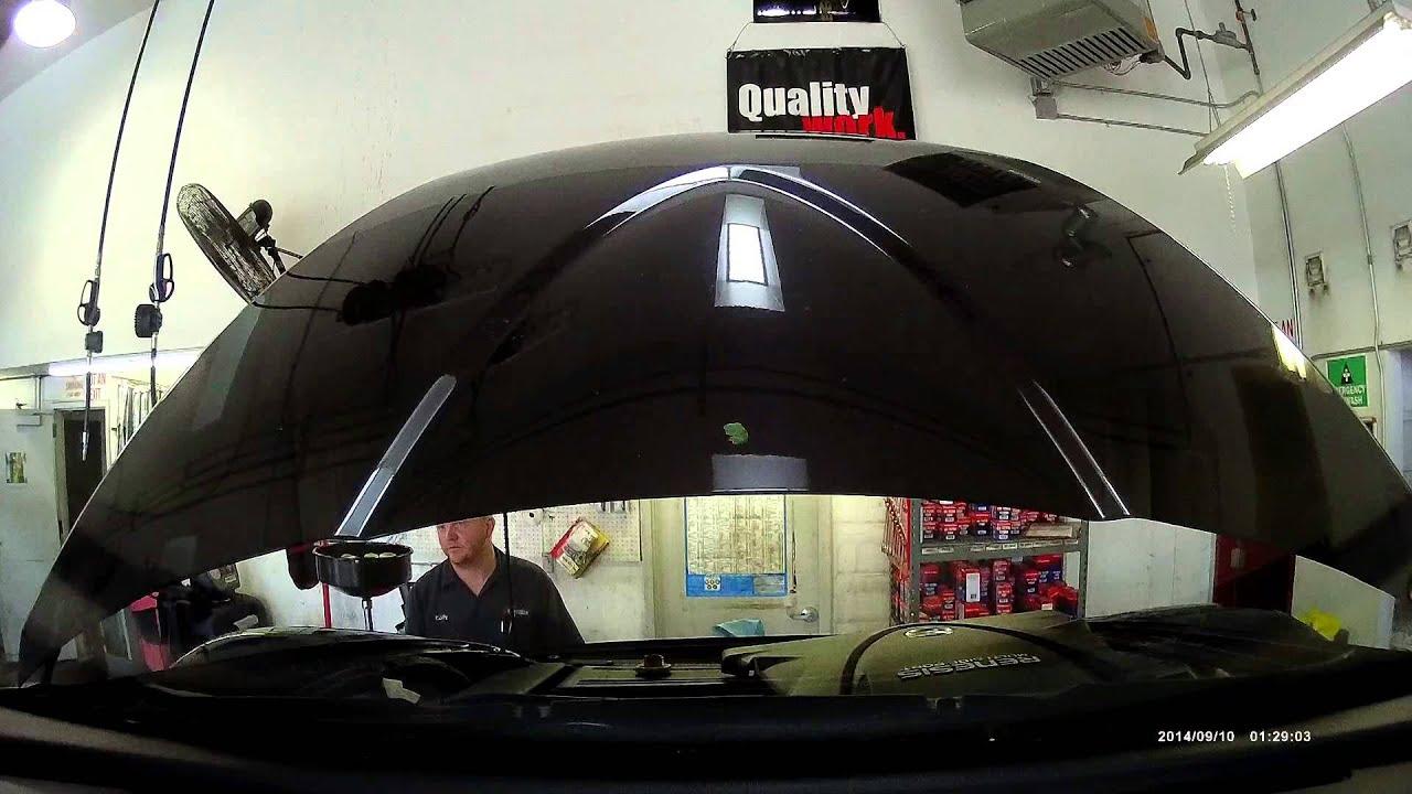 Firestone oil change damaged car